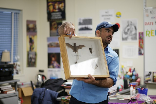 Miguel Ordeñana holds up a box of bat specimens.