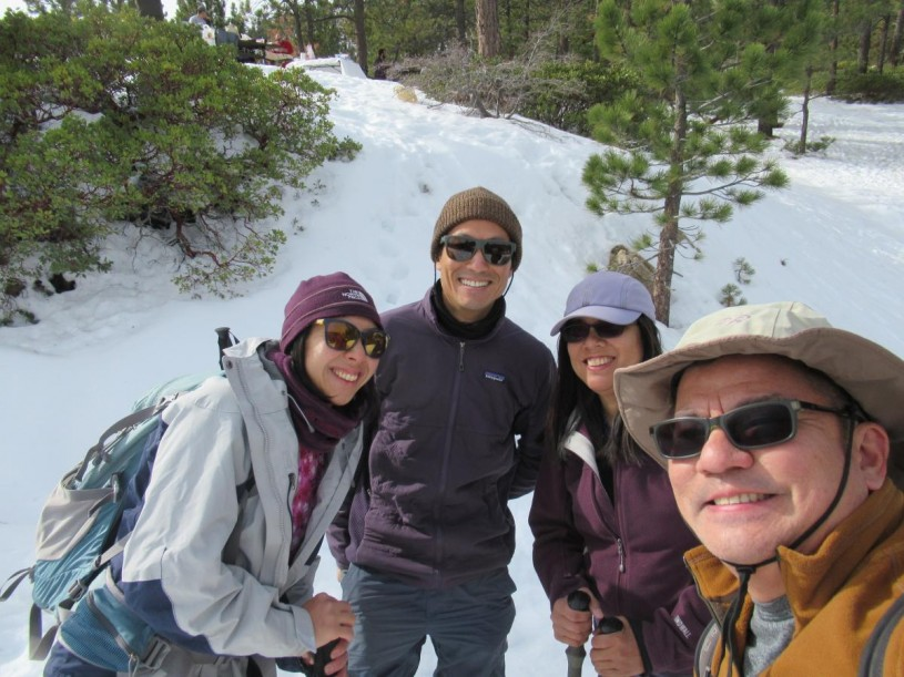 Dennis and his friends hiking in the recent snow in the San Gabriel Mountains.
