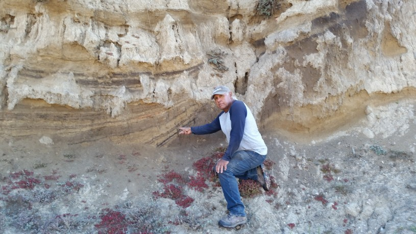 Alan points to a rock wall, where the remains of a 13,000 year old ancestor was found on Santa Rosa island.